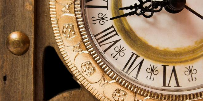 Old wooden clock showing time, close-up.