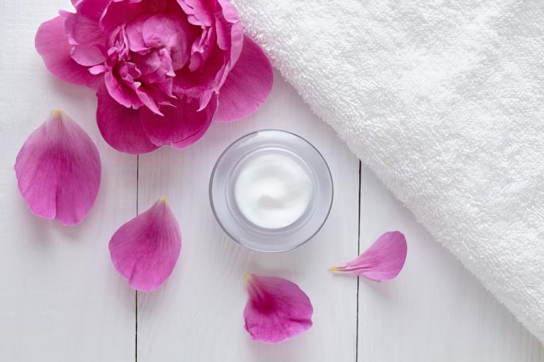 natural herbal moisturizing lotion with pink flower petals